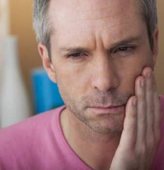 What is oral mucositis?